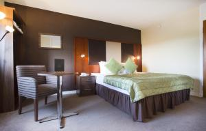 A bed or beds in a room at Normandy Hotel (Near Glasgow Airport)