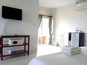 A bed or beds in a room at Smile Hua-Hin Resort