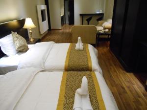 Cama ou camas em um quarto em Shamaat Jeddah Aparthotel