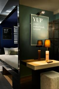The lobby or reception area at YUP Hotel