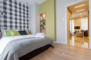 Łóżko lub łóżka w pokoju w obiekcie Apartament Soleil I