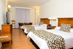A bed or beds in a room at Scala Hotel Buenos Aires
