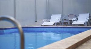 A piscina localizada em Hotel Americas ou nos arredores
