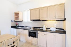 A kitchen or kitchenette at Pefkos Village Resort