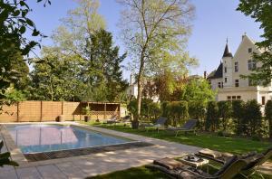 The swimming pool at or near Le Manoir Saint Thomas