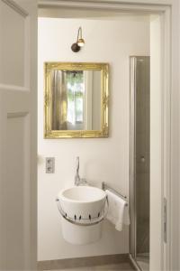 Ein Badezimmer in der Unterkunft Haus San Damiano Kloster