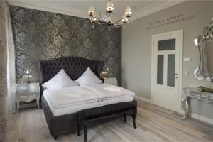Ein Bett oder Betten in einem Zimmer der Unterkunft Haus San Damiano Kloster