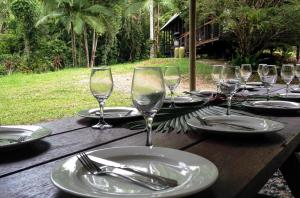 A restaurant or other place to eat at Noah Creek Eco Huts