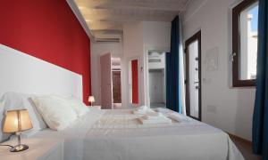 A bed or beds in a room at Hotel Villa Sveva