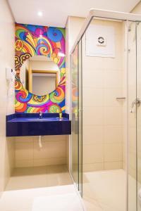Um banheiro em Hotel Caiuá Lago Umuarama