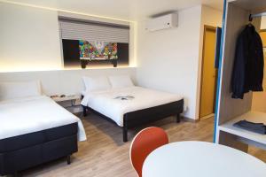 Cama ou camas em um quarto em Hotel Caiuá Lago Umuarama