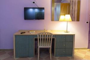 A television and/or entertainment center at Maximo Hotel
