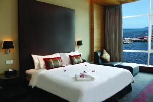 A bed or beds in a room at Grandis Hotels and Resorts