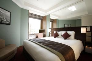 Tempat tidur dalam kamar di Hotel Trusty Tokyo Bayside