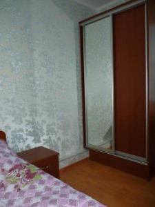 Кровать или кровати в номере Гостевой Дом Березка