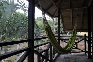A balcony or terrace at Acuali Ecohostal