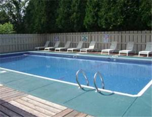 The swimming pool at or near Knights Inn Hadley