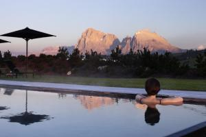 The swimming pool at or near Alpina Dolomites