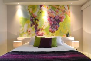 Un ou plusieurs lits dans un hébergement de l'établissement Les Chambres de l'Ady
