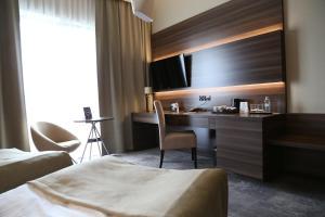Łóżko lub łóżka w pokoju w obiekcie Hotel Atlanta