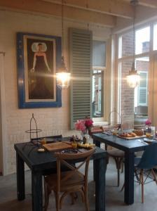 Ein Restaurant oder anderes Speiselokal in der Unterkunft Sonop