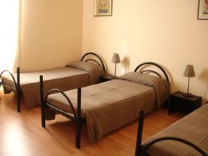 Letto o letti in una camera di Star Hostel