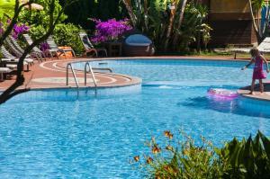 The swimming pool at or near Hotel Cernia Isola Botanica