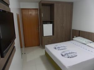 A bed or beds in a room at Hotel CTC