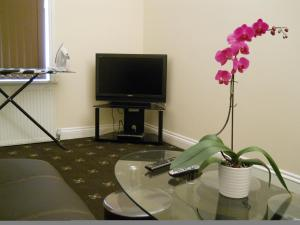 A television and/or entertainment center at Citystay Guest House