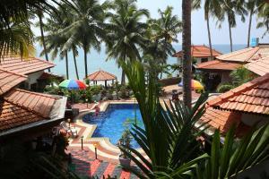 En udsigt til poolen hos Samsara Harmony Beach Resort eller i nærheden