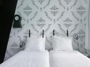 Een bed of bedden in een kamer bij Kaboom Hotel Maastricht