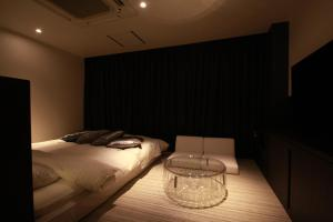 A bed or beds in a room at Hotel Edoyado (Adult Only)