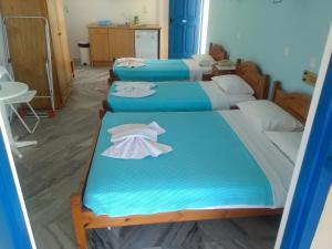 Un ou plusieurs lits dans un hébergement de l'établissement Damias Village