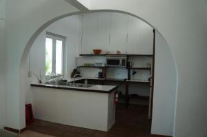 A kitchen or kitchenette at Bravo Beach Hotel