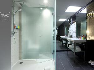 A bathroom at TWO Hotel Barcelona by Axel 4* Sup- Adults Only