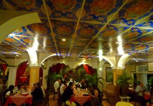 A restaurant or other place to eat at Little Italy Hotel