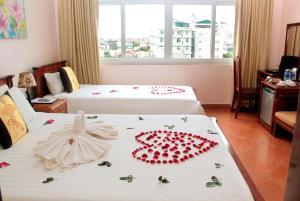 Cama o camas de una habitación en Holiday Diamond Hotel