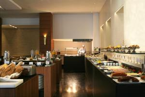 A restaurant or other place to eat at Aquila Atlantis Hotel