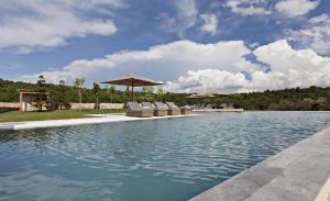 The swimming pool at or near La Vella Farga Hotel