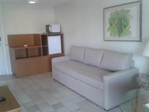 A seating area at Jatiúca Resort Flat 404