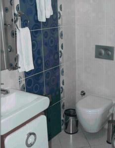 Ein Badezimmer in der Unterkunft Tac Hotel