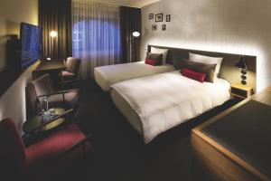 A bed or beds in a room at pentahotel Brussels City Centre