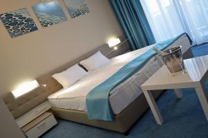 Кровать или кровати в номере Arena Mar Hotel and SPA