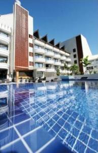 A piscina localizada em Hotel Tahiti Nui ou nos arredores