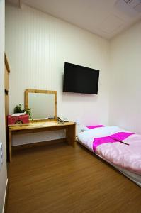 A television and/or entertainment center at Myeongdong Ecohouse