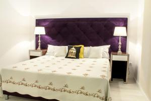 Cama o camas de una habitación en Santa Cruz Apartments