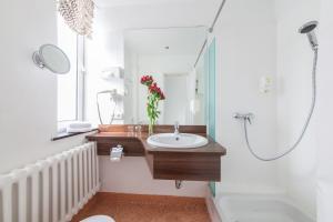 Ein Badezimmer in der Unterkunft Novum Hotel Bremer Haus