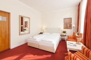 Ein Bett oder Betten in einem Zimmer der Unterkunft Novum Hotel Bremer Haus