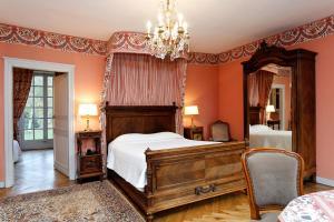 A bed or beds in a room at Château du Landel, The Originals Relais (Relais du Silence)
