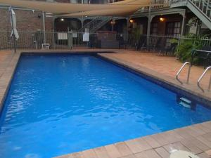 The swimming pool at or near City Colonial Motor Inn